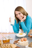 Baking - Smiling woman with healthy ingredients Royalty Free Stock Photography