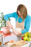 Baking - Smiling woman with healthy ingredients Stock Photo