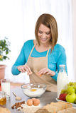 Baking - Smiling woman with healthy ingredients Stock Image