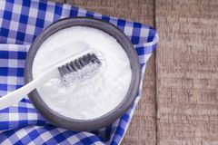 Baking soda and brush. On the wooden table royalty free stock photography