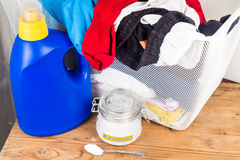 Baking soda with detergent and pile of dirty laundry. Stock Images