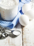 Baking soda, flour and eggs on wooden table. Royalty Free Stock Images