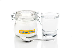 Baking soda in jar, spoonful and glass of water for multiple hol. Istic usages Stock Images