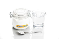 Baking soda in jar, spoonful and glass of water for multiple hol Royalty Free Stock Photography