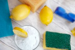 Baking soda with lemon and cleaning brush. On the table. Top view royalty free stock images