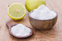 Baking soda. With lemon on wooden background Stock Image