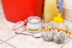 Baking soda with pail, mop, detergent for house cleaning. Stock Photography