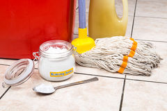 Baking soda with pail, mop, detergent for house cleaning. Baking soda with pail, mop, detergent for house cleaning royalty free stock photos