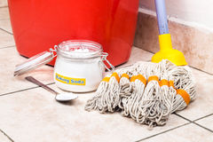 Baking soda with pail, mop, detergent for house cleaning. Baking soda with pail, mop, detergent for house cleaning royalty free stock photography