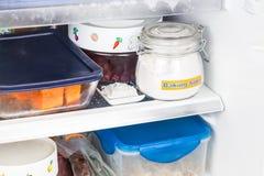 Baking soda placed in refrigerator to deodorize bad odor. Stock Photos