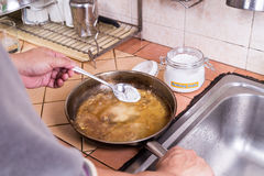 Baking soda to soak and remove burnt-on food in pans Stock Images