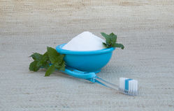 Baking Soda in Turquoise Bowl, Toothbrush and Fresh Mint Stock Photos