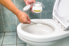 Baking soda used to clean and disinfect bathroom and toilet bowl Stock Image