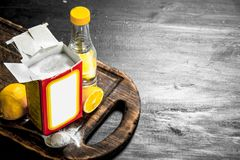 Baking soda with vinegar and lemon. stock photography