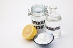 Baking soda. Vinegar and lemon on the white background royalty free stock photo