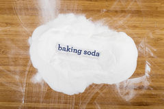 Baking soda. On wooden board with word royalty free stock photo