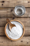 Baking soda. In a wooden bowl Royalty Free Stock Image