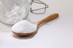 Baking soda. Wooden spoon full of baking soda on the white background Stock Photos