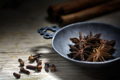 Baking spices, star anise, cinnamon and cloves on a rustic woode Royalty Free Stock Images