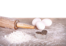 Baking still life, flour, eggs and rolling pin Royalty Free Stock Photography