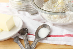 Baking still life with old measuring spoons Stock Photos