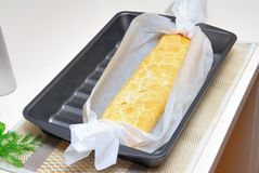 Baking Swiss roll in parchment Stock Images