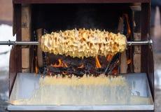 Baumkuchen baking process. Baking technique of Lithuanian sakotis or Raguolis also known as Bamkuchenas in western Lithuania or Polish sÄ™kacz. It is a royalty free stock photos