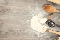 Baking tools with copy space. Baking tools from overhead view on wooden table in vintage tone, copy space on side Royalty Free Stock Images