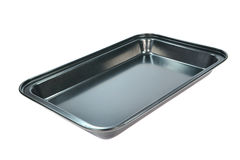 Baking tray. An clean empty baking tray on a white background Royalty Free Stock Images