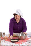In the baking tray. Woman showing the mixture in her baking tray Royalty Free Stock Photo