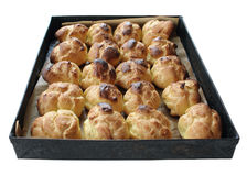 Baking tray with choux pastry ball, isoleted. Homemade choux pastry ball on the baking tray isoleted on white Royalty Free Stock Photo