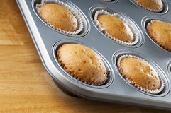 Baking tray and cupcakes Stock Photo