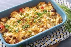 Baking tray with delicious turkey casserole on table. Closeup stock photo