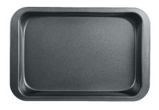 Baking tray. Empty baking tray isolated on white royalty free stock images
