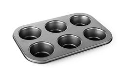 Muffins baking tray. Baking tray or pan for cooking muffin and cupcake isolated on a white background royalty free stock images