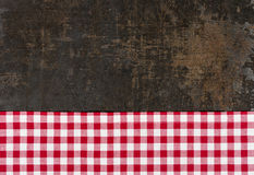 Baking tray with a red checkered tablecloth. Antique baking tray with a red checkered tablecloth stock photos
