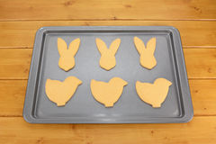 Baking tray with six Easter cookies Stock Photos