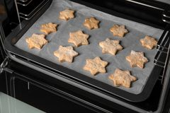 Baking tray with tasty Christmas cookies Stock Image