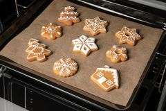 Baking tray with tasty Christmas cookies Royalty Free Stock Photography