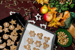Baking trays with gingerbread christmas cookies Royalty Free Stock Images