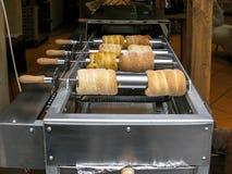 Baking trdelnik pastry, Prague Stock Images