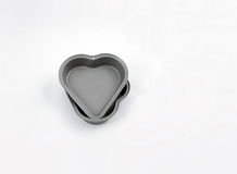 Baking two heart tart tins, kitchen related Royalty Free Stock Photo
