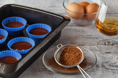 Baking utensils and recipe ingredients on pastel light blue back Royalty Free Stock Photos