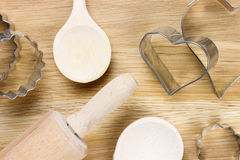 Baking utensils on a wooden surface Stock Photos