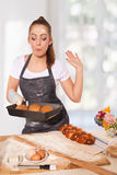 Baking woman admiring a perfect rye loaf Stock Image