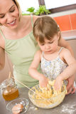 Baking - Woman with child preparing dough Royalty Free Stock Images