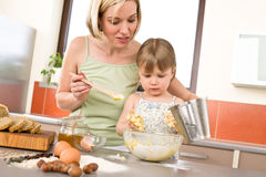 Baking - Woman with child preparing dough royalty free stock photos