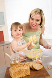 Baking - Woman with child preparing dough. With healthy ingredients stock images