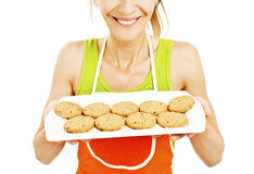 Baking woman showing cookies on tray Stock Photo