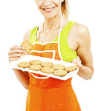 Baking woman showing cookies on tray Stock Photography